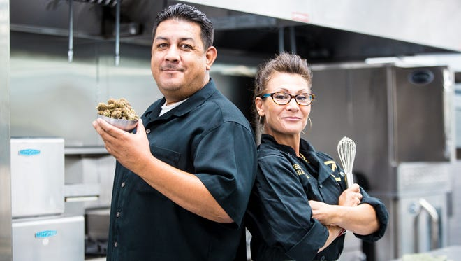 COO Raul Molina and Chef Carylann Principal stand inside The Mint Dispensary's new full-service kitchen which will serve medical marijuana-infused meals.