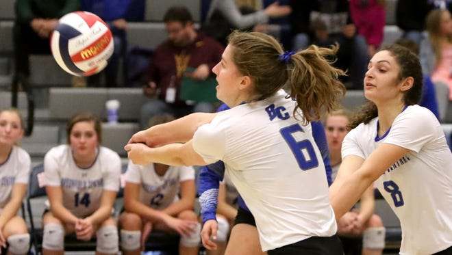 Brookfield Central's Cami Herman bumps a serve against Divine Savior Holy Angels in a WIAA sectional final at Brookfield East on Oct. 28.