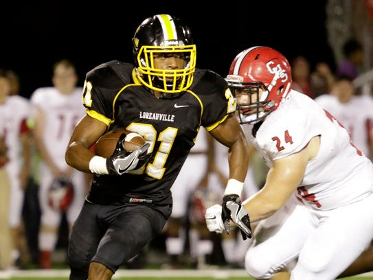 Loureauville running back Shae'ahn Lee looks for a