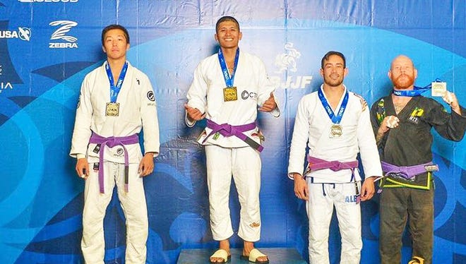 Jon Andrew delos Reyes of Cobra Kai Jiu Jitsu proudly takes the podium with his gold medal after winning his division at the Long Beach International Open 2017 IBJJF Jiu Jitsu Championships.  Taking Silver was Vincent Wai Sit of Kowloon BJJ, and tied for bronze were Brandon Gonzalez of Brazilian Top Team and Ryan Mohn of Peninsula BJJ.