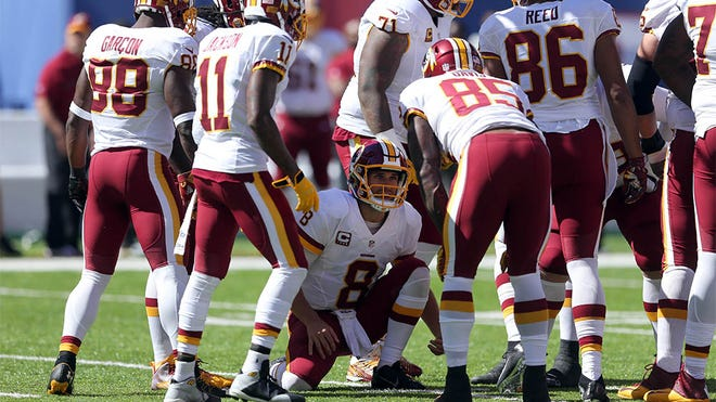 Sep 25, 2016; East Rutherford, NJ, USA; Washington Redskins quarterback Kirk Cousins (8) huddles with teammates during the first quarter against the New York Giants at MetLife Stadium. Mandatory Credit: Brad Penner-USA TODAY Sports