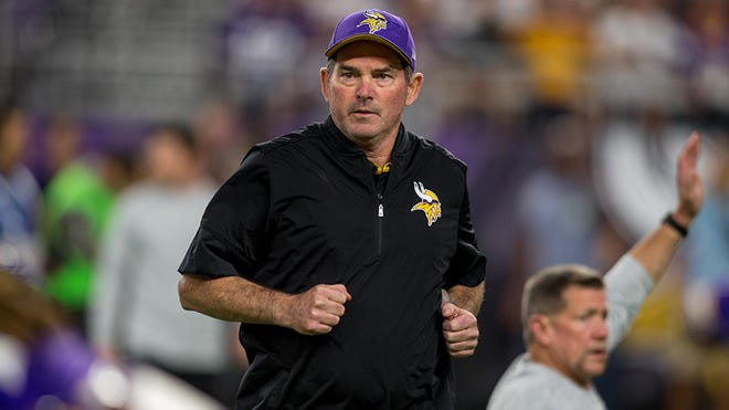 Sep 18, 2016; Minneapolis, MN, USA; Minnesota Vikings head coach Mike Zimmer moves between players he greets before the game against the Green Bay Packers at U.S. Bank Stadium. The Vikings win 17-14. Mandatory Credit: Bruce Kluckhohn-USA TODAY Sports