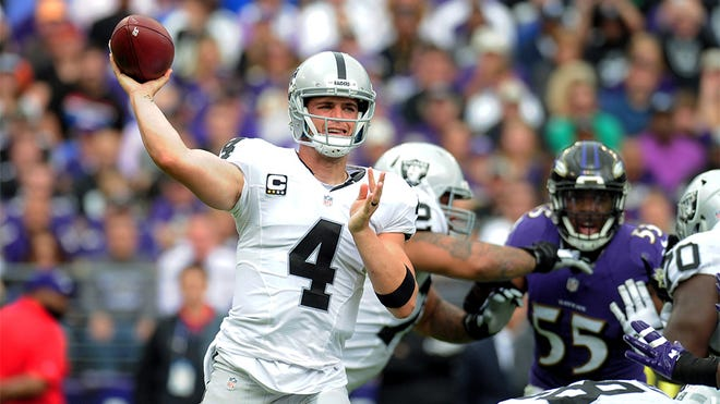 Oct 2, 2016; Baltimore, MD, USA; Oakland Raiders quarterback Derek Carr (4) throws a pass in the first quarter against the Baltimore Ravens at M&T Bank Stadium. Mandatory Credit: Evan Habeeb-USA TODAY Sports