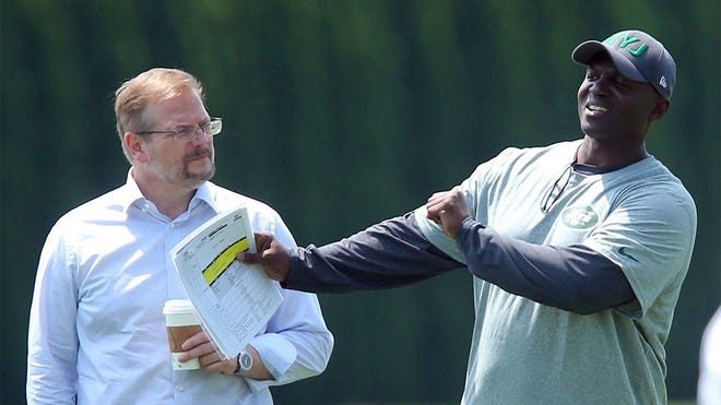 May 8, 2015; Florham Park, NY, USA; New York Jets general manager Mike Maccagnan (left) and head coach Todd Bowles watch rookie minicamp at the Atlantic Health Jets Training Center. Mandatory Credit: Brad Penner-USA TODAY Sports usp ORG XMIT: USATSI-225398 [Via MerlinFTP Drop]