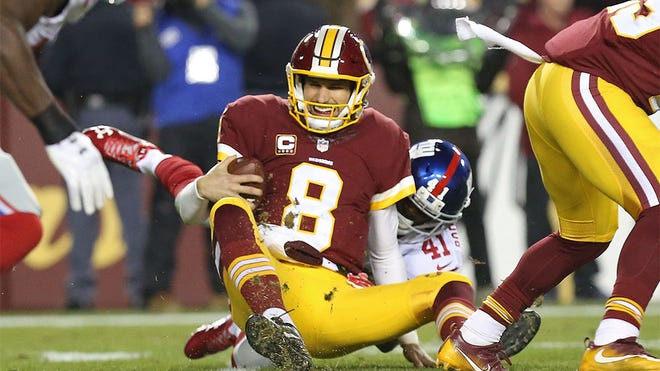 Jan 1, 2017; Landover, MD, USA; Washington Redskins quarterback Kirk Cousins (8) is sacked by New York Giants cornerback Dominique Rodgers-Cromartie (41) in the second quarter at FedEx Field. Mandatory Credit: Geoff Burke-USA TODAY Sports