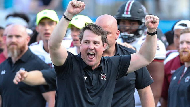 Sep 2, 2017; Charlotte, NC, USA; South Carolina Gamecocks head coach Will Muschamp reacts to the victory as North Carolina State Wolfpack was unable to convert at the goal line during the second half at Bank of America Stadium. Mandatory Credit: Jim Dedmon-USA TODAY Sports