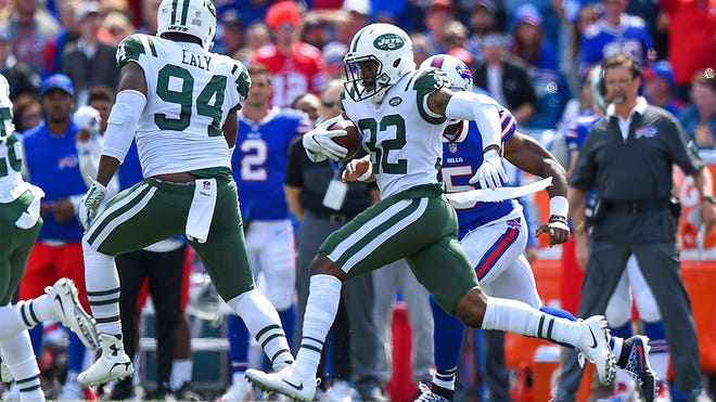 Sep 10, 2017; Orchard Park, NY, USA; New York Jets cornerback Juston Burris (32) returns an interception against the Buffalo Bills during the first quarter at New Era Field. Mandatory Credit: Rich Barnes-USA TODAY Sports
