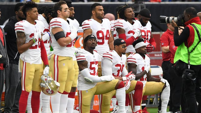 Dec 10, 2017; Houston, TX, USA; San Francisco 49ers outside linebacker Eli Harold (57), strong safety Eric Reid (35), and wide receiver Marquise Goodwin (11) kneel for the national anthem prior to the game against the Houston Texans at NRG Stadium. Mandatory Credit: Shanna Lockwood-USA TODAY Sports ORG XMIT: USATSI-359040 ORIG FILE ID:  20171210_sal_lb9_1576.JPG