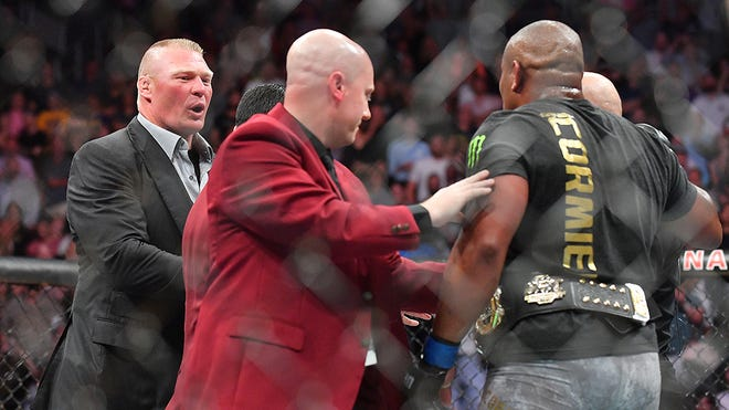 LAS VEGAS, NV - JULY 07:  Brock Lesnar (L) confronts Daniel Cormier (R) after his  heavyweight championship fight against Stipe Miocic at T-Mobile Arena on July 7, 2018 in Las Vegas, Nevada. Cormier won by first round knockout.  (Photo by Sam Wasson/Getty Images) ORG XMIT: 775143816 ORIG FILE ID: 993559300