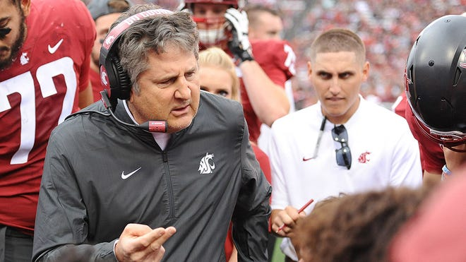 Sep 15, 2018; Pullman, WA, USA; Washington State Cougars head coach Mike Leach talks with his team on the sideline during a football game against the Eastern Washington Eagles in the first half at Martin Stadium. Mandatory Credit: James Snook-USA TODAY Sports