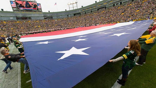 Sep 30, 2018; Green Bay, WI, USA; A patriotic banner is held on the field prior to the game between the Buffalo Bills and Green Bay Packers at Lambeau Field. Mandatory Credit: Jeff Hanisch-USA TODAY Sports