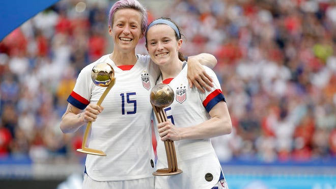 Jul 7, 2019; Lyon, FRANCE; United States forward Megan Rapinoe (15) and midfielder Rose Lavelle (16) with the golden ball and bronze ball after the championship match of the FIFA Women's World Cup France 2019 against the Netherlands at Stade de Lyon.  Mandatory Credit: Alex Martin/Presse Sports via USA TODAY Sports