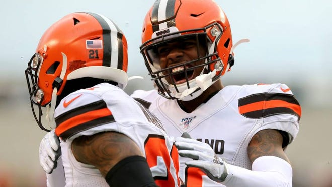 Browns cornerback Denzel Ward, left, is congratulated by cornerback Greedy Williams after intercepting a pass in the third quarter of a game in December. [Associated Press]