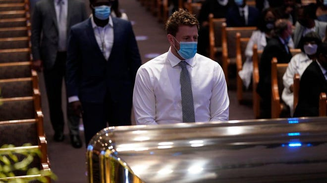 The Texans' J.J. Watt pauses by the casket of George Floyd during a funeral service for Floyd in Houston on Tuesday.
