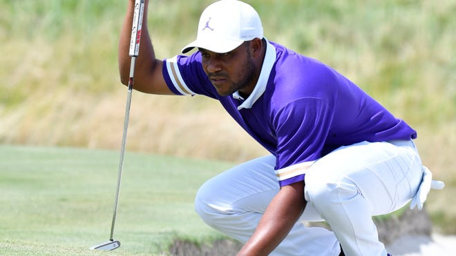 Harold Varner III lines up his putt on the 2nd green during the final round of the 2019 Northern Trust at Liberty National. Photo: Mark Konezny/USA TODAY Sports