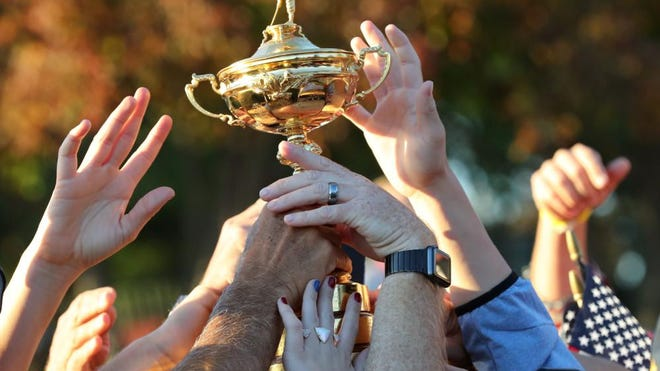 Oct 2, 2016: Fans touch the Ryder Cup during the closing ceremonies after the single matches in 41st Ryder Cup at Hazeltine National Golf Club.
