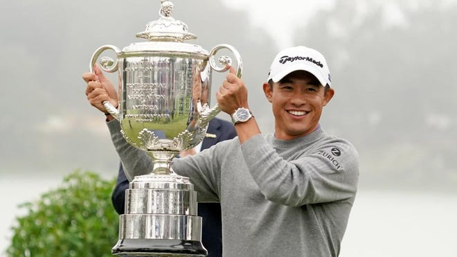 Collin Morikawa celebrates with the Wanamaker Trophy after winning the 2020 PGA Championship golf tournament at TPC Harding Park, Sunday, Aug 9, 2020.