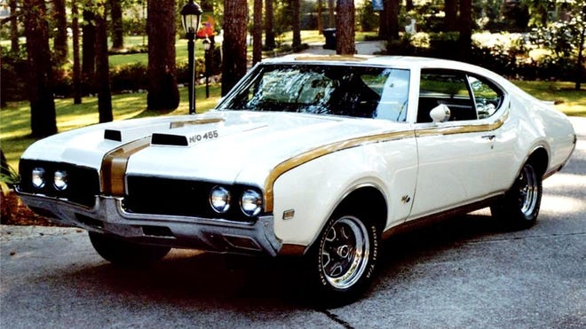 The 1969 Hurst Olds 442 is one of the more desirable muscle cars from the 1960s. Both featured 455-inch Rocket V8s with 390 horsepower. Only 515 were built in 1968 and 906 were assembled in 1969. This 1969 came only in white and gold, while the 1968 featured a black and silver motif.