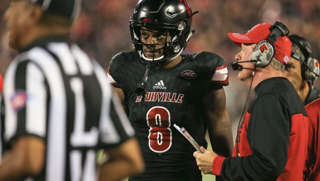 Louisville quarterback Lamar Jackson and head coach Bobby Petrino had a grind-it-out game against a scrappy Duke team. Jackson had two touchdowns, one rushing for 144 net yards and 13-for-26 passing for 181 yards with one sack to help lead the Cardinals to a 24-14 win Friday night, Oct. 14.