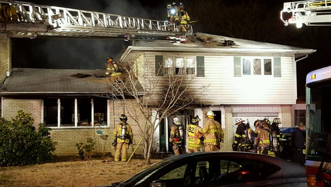 Gloucester Township firefighters respond to a house blaze last year. A local church will honor firemen, police and EMS personnel at a Love Your Community service Sunday