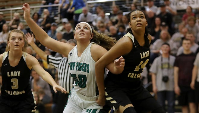 Triton Central's Isabella Cooper (50) and Winchester's Kira Robinson battle for position in Saturday's Class 2A regional final at Speedway. Winchester won 56-32.