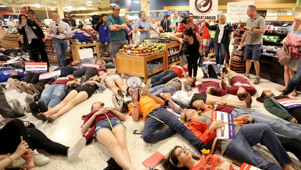 Demonstrators lie on the floor at a Publix...
