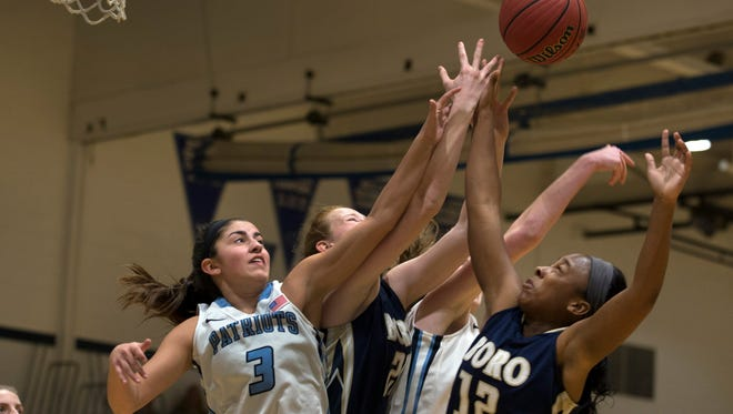 Freehold Township's Theresa Sanzone and Freehold Boro's Shalanda Hickman battle for a rebound during first half action. Freehold Township vs Freehold Boro Girls Basketball in Freehold Township, NJ on January 19, 2017.