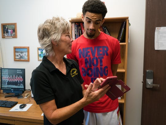 Patty Curtiss, a former athletic trainer at College of the Desert, counsels with a student-athlete at the Palm Desert campus in 2016.