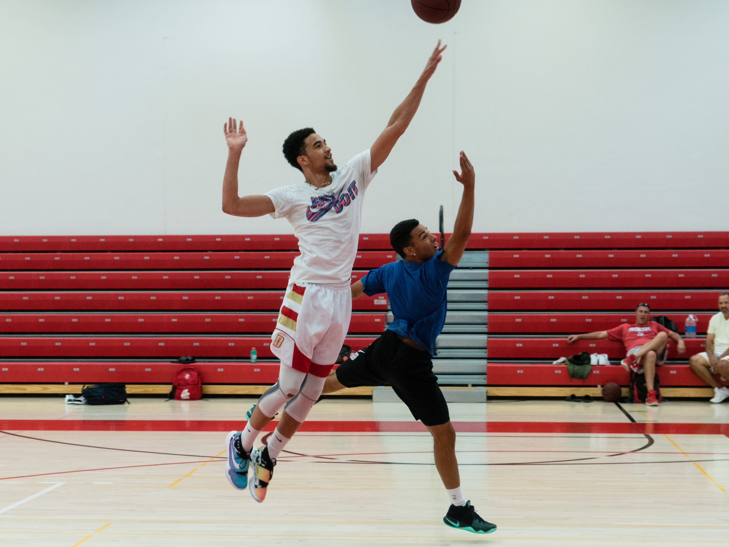 Philippe Salawa practices with a teammate at College