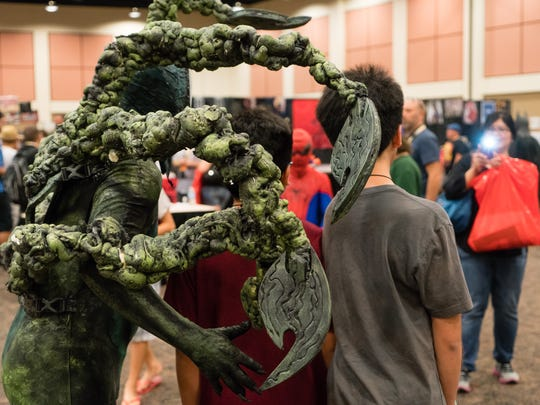 Cosplayers dressed in popular costumes find themselves frequently asked for photographs at Comic Con Palm Springs.