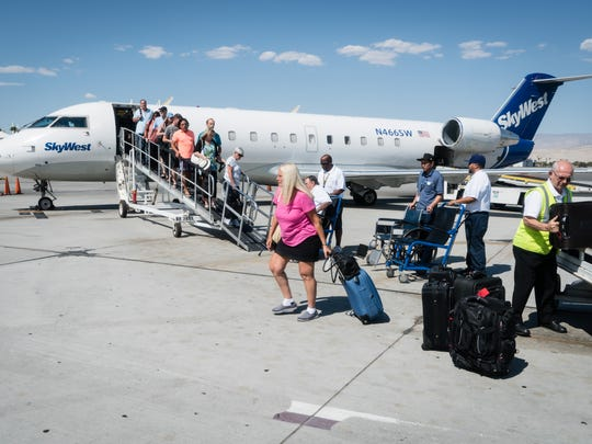Passengers on the tarmac at Palm Springs International Airport board a SkyWest operated flight this summer.
