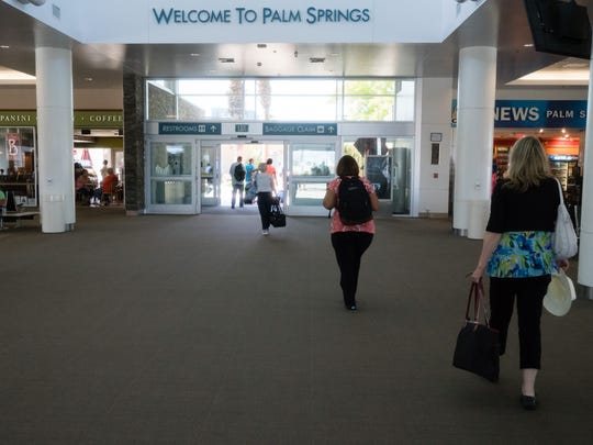 Passengers arrive at Palm Springs International Airport on Tuesday afternoon.