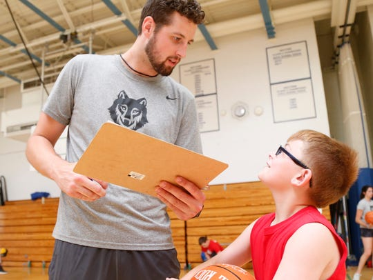 Zach Lydon speaks with camper , Kassey Stickle during