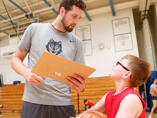 Zach Lydon speaks with camper , Kassey Stickle during the inaugural Tyler Lydon Dream Big Basketball Camp at Stissing Mountain High School on June 26, 2018.