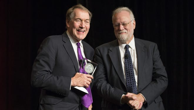Charlie Rose (left)  receives an award from ASU Provost Dr. Mark Searle during the 32nd annual Cronkite Award Luncheon at the Sheraton in downtown Phoenix on Oct. 19, 2015. Rose was the recipient of the Walter Cronkite Award for Excellence in Journalism.