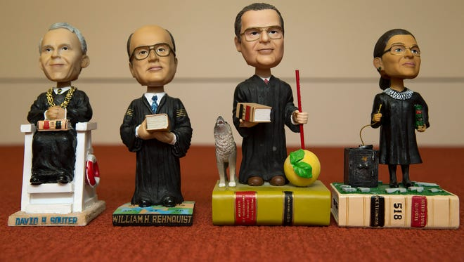 Bobblehead dolls representing Supreme Court Justices, from left, David Souter, William Rehnquist, Antonin Scalia, and Ruth Ginsburg, in Washington.