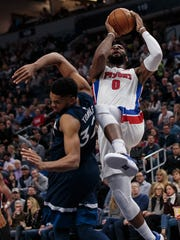 Pistons center Andre Drummond (0) shoots in the first quarter against Timberwolves center Karl-Anthony Towns (32) on Sunday, Nov. 19, 2017, in Minneapolis.