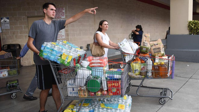 Shoppers at Costco waited up to eight hours for water and essentials in preparation for Hurricane Irma in North Miami.