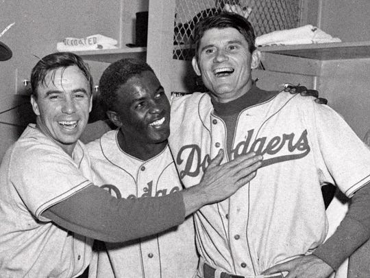 Brooklyn Dodgers from left, Pee Wee Reese, Jackie Robinson and Preacher Roe in 1952.