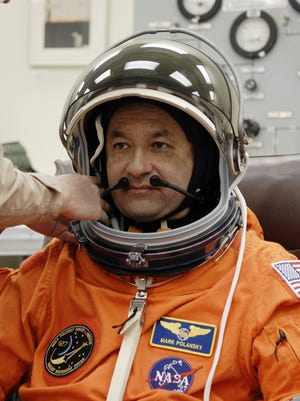 In the Operations and Checkout Building at NASA's Kennedy Space Center in Florida, STS-127 Commander Mark Polansky checks the communication system in his helmet.
