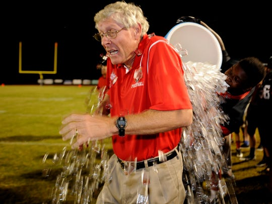 Stewarts Creek coach David Martin gets an ice cold bath from Jerry Carnell (21) seconds before clinching their first victory in school history by defeating Summit 52-28 in 2013. The two schools get a rematch Friday.