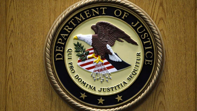 A U.S. Department of Justice logo is shown in this 2010 file photo.