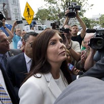 Pennsylvania Attorney General Kathleen Kane arrives to be processed and arraigned Aug. 8 at the Montgomery County detective bureau in Norristown, Pennsylvania.