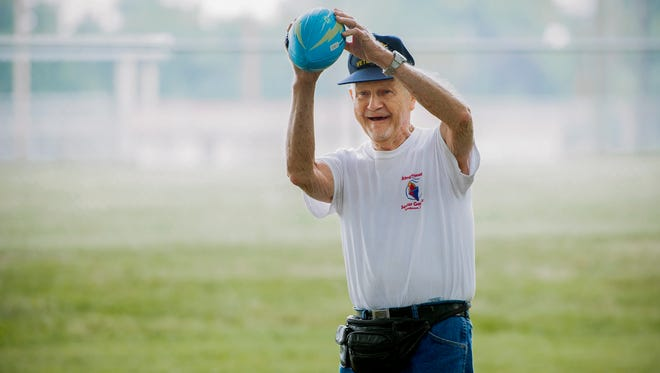 Gil Thomas, 91, of Henderson, competes in the football throw during the 33rd annual Henderson Senior Games at Atkinson Park on Sept. 15. The event is organized by The Gathering Place senior center and is open to anyone living in Henderson County over the age of 50.