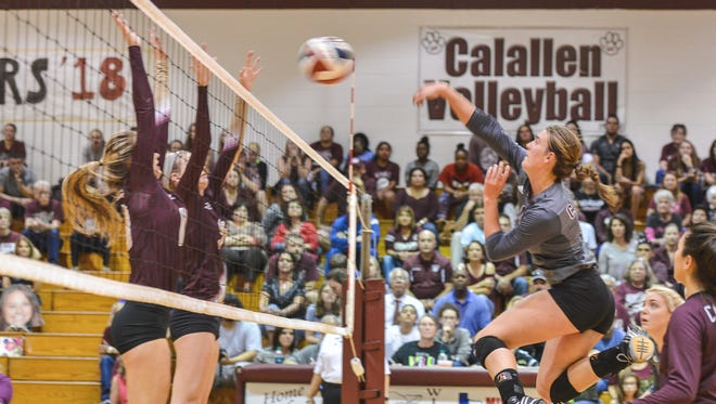 Calallen's Alexis Sacky (12) returns the ball to Tuloso-Midway during a District 30-5A match on Tuesday, Oct. 25, 2016 at Calallen High School.