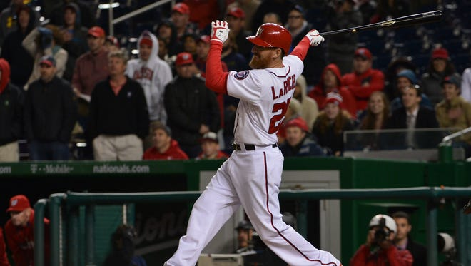 Washington Nationals first baseman Adam LaRoche hits a walk off single in the ninth inning at Nationals Park.