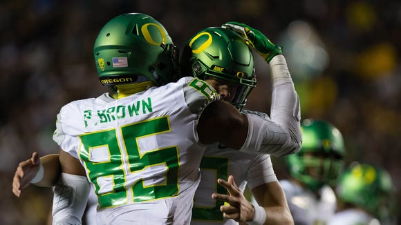 Oct 21, 2016; Berkeley, CA, USA; Oregon Ducks tight end Pharaoh Brown (85) celebrates with quarterback Justin Herbert (10) after scoring a touchdown against the California Golden Bears during the second quarter at Memorial Stadium. Mandatory Credit: Kelley L Cox-USA TODAY Sports