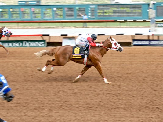 Cody Jensen winning the 2014 Ruidoso Futurity aboard champion Kiss My Hocks.