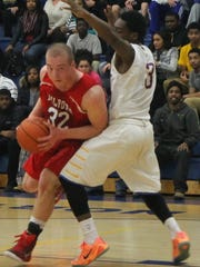 Milford junior forward Ben Greenwell works for position