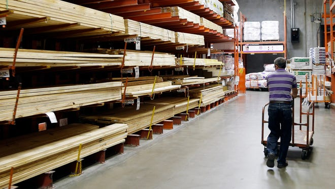 A customer walks past building products at a Home Depot store in Nashville.